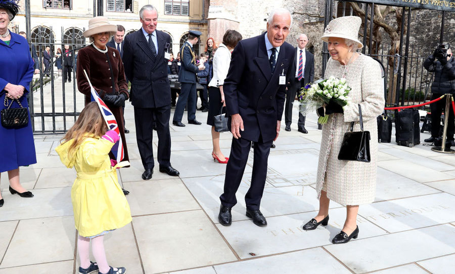 Queen Elizabeth couldn't contain her smile when meeting a little girl who hid her face from the British monarch during her visit to the Charterhouse in London in February 2017. 