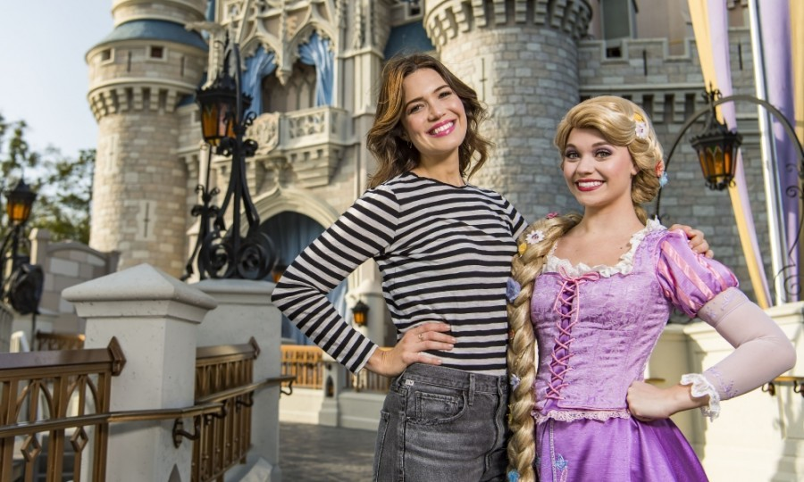 March 6: Mandy Moore happily posed with Rapunzel during a visit to Disney's Magic Kingdom in Lake Buena Vista, Florida. The star reprised her voiceover role as Rapunzel for the Disney Channel show <i>Tangled: The Series</i>. 