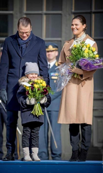 Estelle held on tight to a bouquet of flowers as the Swedish royals greeted well-wishers in front of the palace.