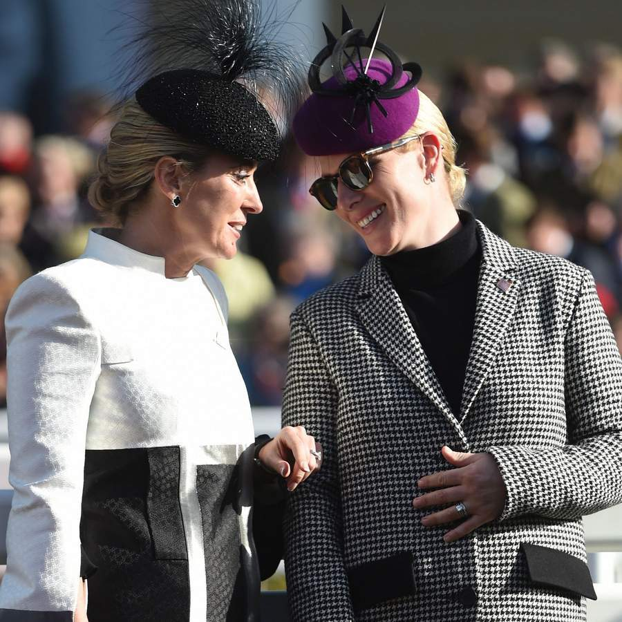 Princess Anne's daughter Zara Tindall had her own pair of cool sunglasses as she chatted with Chanelle McCoy, wife of retired jockey AP McCoy, at Cheltenham Racecourse in Gloucestershire, south-west England.