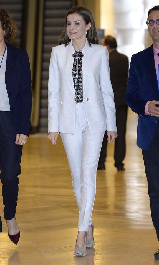 Queen Letizia of Spain suited up in white at an event in El Prado Museum in Madrid. 