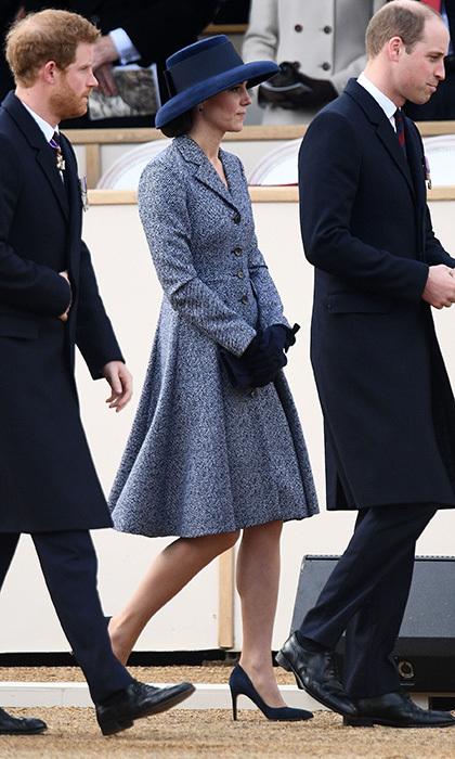 Joining brother-in-law Prince Harry, left, and husband Prince William at a Service of Commemoration and Drumhead Service on Horse Guards Parade in central London, Kate Middleton chose a wide-brimmed hat to go along with her Michael Kors coat.
