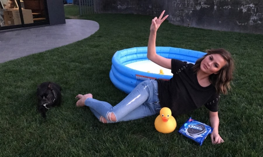 "March 14: Strike a pose! After doing the OREO dunk challenge, Chrissy Teigen tweeted a photo with the caption: ""My neighbors love me! @oreo #OreoDunkChallenge #ad""