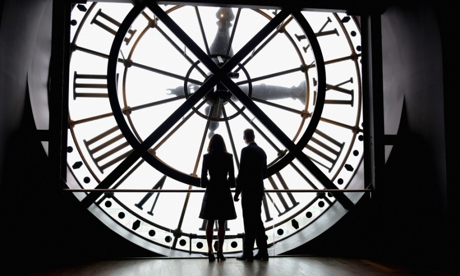 The couple shared a sweet moment at the Musee d'Orsay, overlooking the most romantic city in the world through a clock.