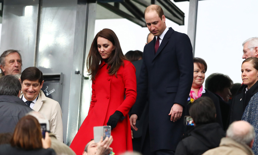 The Duchess stunned, as always, in a red Carolina Herrera coat. The crowd was thrilled to see them as they walked through the stadium.