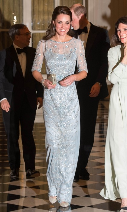 In the evening, Kate glammed up for a black tie dinner at the British Embassy. The royal sparkled in a frosty blue dress from one of her favorite designers, Jenny Packham. She accessorized the frozen look with dazzling Oscar de la Renta heels and glistening earrings (on loan from Queen Elizabeth II).