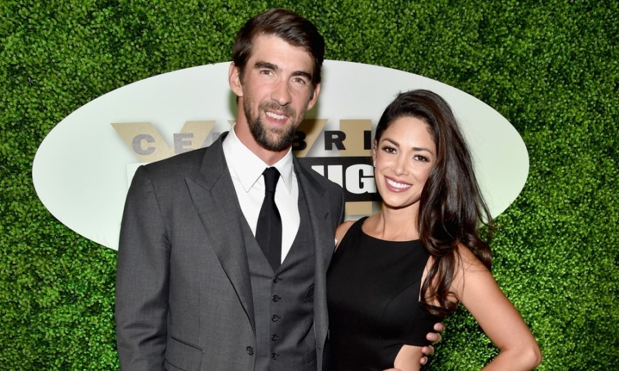 "March 18: Celebrity fight night! Michael Phelps and his wife Nicole enjoyed a night out together for Muhammad Ali's ""Celebrity Fight Night"" at the JW Marriott Desert Ridge Resort & Spa in Phoenix, Arizona.