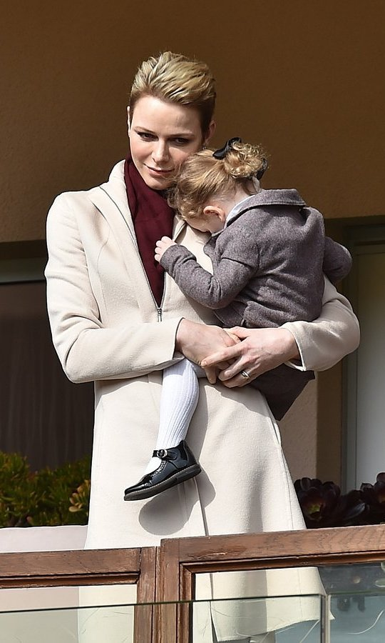 Princess Charlene of Monaco, also mom to two-year-old Prince Jacques, gave daughter Princess Gabriella a cuddle during the Sainte Devote Rugby Tournament in Monte-Carlo.
