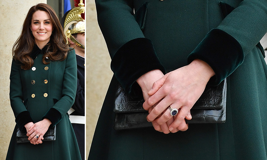 The Duchess complimented her green Catherine Walker coat with a leather envelope clutch by <b>Etui</B> during a trip to Paris in March 2017.