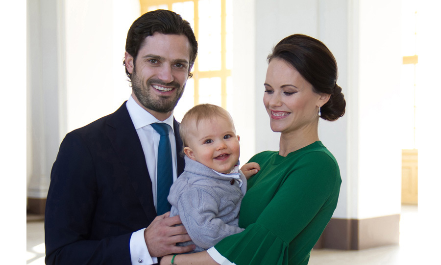 Prince Alexander showed off his new teeth in a photo with his parents Prince Carl Philip and Princess Sofia. One month before the little royal turns one, his parents released this portrait to share the exciting news that they are expecting a sibling for their son in September 2017.