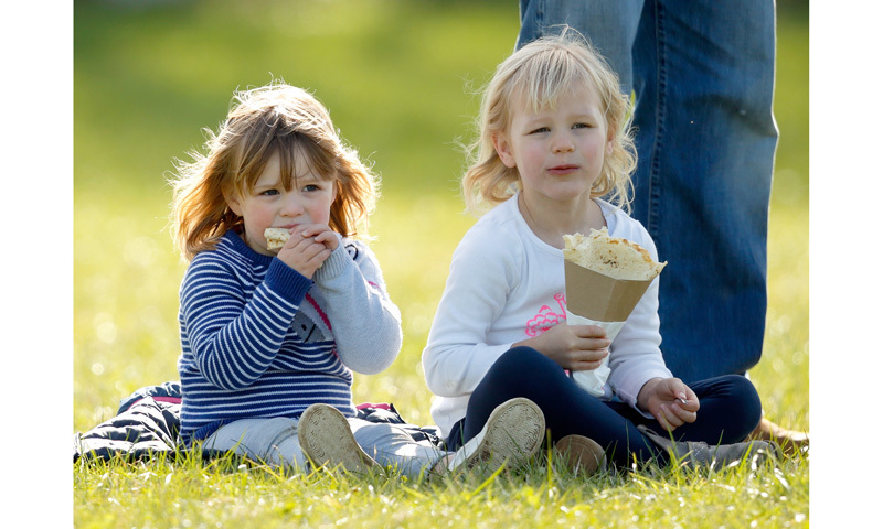 Mia, snacking on crepes with her cousin Isla.