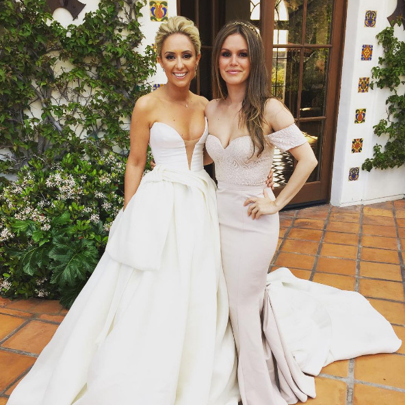 "<b>Rachel Bilson</b> was a blushing bridesmaid for <i>Hart of Dixie</i> set costumer Gelareh Khalioun's wedding at the Hummingbird Nest in Susana, California. Hayden Christensen's longtime love captioned the photo, ""My #HOD girls @wipeyoownass @kachtmeyer celebrating @gegelspot @elijah_medge."" The mom-of-one also jokingly added #alwaysabridesmaid.""