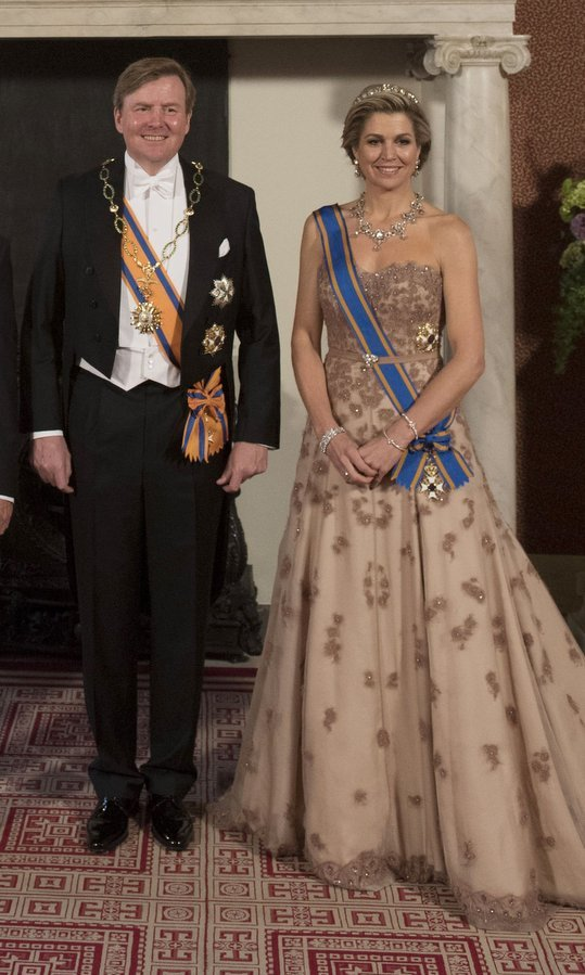 Talk about regal! Queen Maxima of the Netherlands was picture perfect in her strapless Jan Taminiau gown as she joined husband King Willem-Alexander to host a state banquet for President Mauricio Macri of Argentina and his wife Juliana Awada on March 27 at the Royal Palace in Amsterdam. It was the same dress the queen wore for her brother Juan Zorreguieta's wedding back in 2014. 