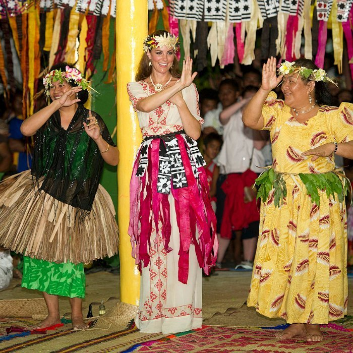 Kate went bohemian during her tour of Asia wearing a full-length Temperley dress featuring cross-stitching for a night of dancing in Tuvalu.