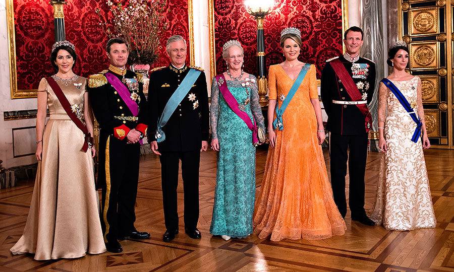 Talk about a glamorous lineup! From left to right: Crown Princess Mary and Crown Prince Frederik of Denmark; King Philippe of Belgium, Queen Margrethe of Denmark, Queen Mathilde of Belgium,  and Prince Joachim and Princess Marie of Denmark turned out in their finest for a state banquet in the Belgian royals' honor on March 28 at Christiansborg Castle in Copenhagen. 