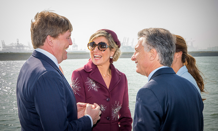 Queen Maxima of the Netherlands had it made in the shades with husband King Willem-Alexander, left, Argentina's President Mauricio Macri and his wife Juliana Awada during a boat trip in the harbor of Rotterdam on March 28. 