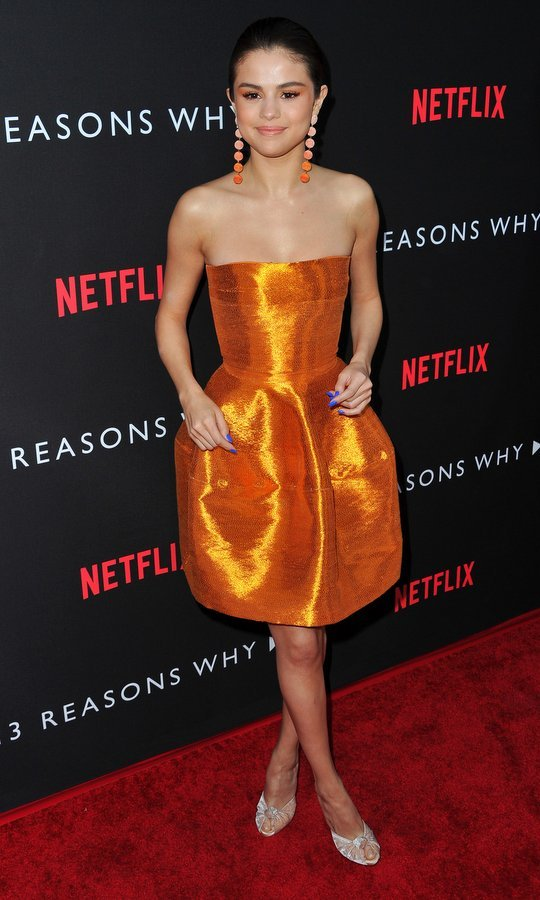 March 30: Selena Gomez's bright makeup complemented her metallic dress at the premiere of Netflix's '13 Reasons Why' at Paramount Pictures in Los Angeles. 