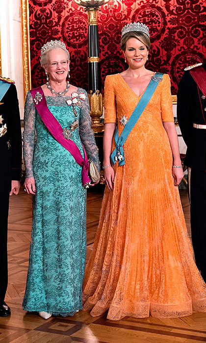 Queen Margrethe of Denmark, left, and Queen Mathilde of Belgium both opted for bold hues for the state dinner in honor of the Belgian royals on March 28 at Christiansborg Castle in Copenhagen.
