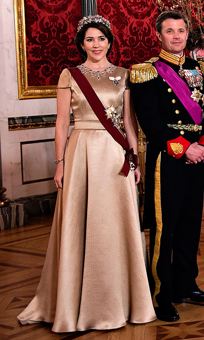 Crown Princess Mary's simple satin gown set off her stunning jewels at the state dinner on March 28 at Christiansborg Castle.
