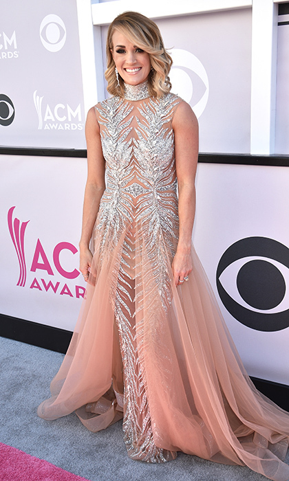 April 2: Carrie Underwood sparkled in a gown by LaBourjoisie at the 52nd Academy Of Country Music Awards at Toshiba Plaza in Las Vegas, Nevada. 
