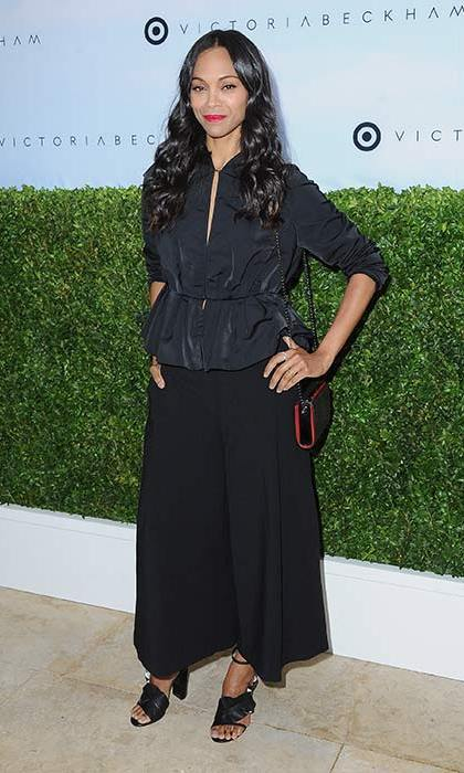 April 1: New mom Zoe Saldana looked chic in this black blouse and wide leg cullottes styled with strappy sandals. Loose waves and a pop of red lipstick completed the look.