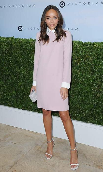 April 1: Ashley Madewke was pretty in pink in this long sleeved dress with contrasting white collar and cuff details.