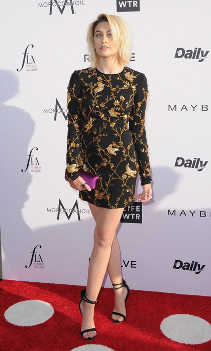 Paris wore a gold and black Naeem Khan mini paired with a purple Jimy Choo clutch to the Daily Front Row Fashion L.A. Awards.