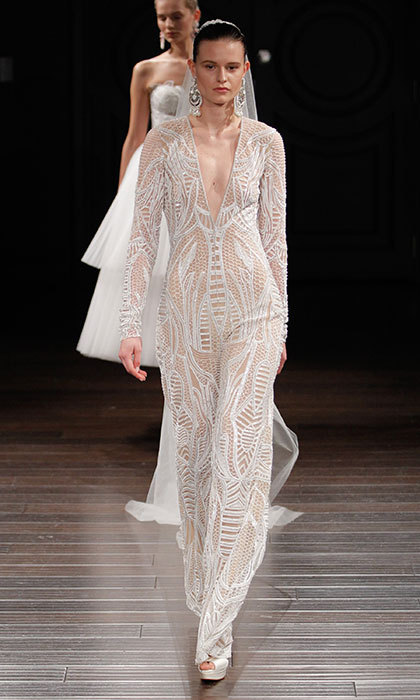 <b>Naeem Khan</b> also showed that jumpsuits aren't just a go-to look for day- and eveningwear. Here, he gives one the bridal treatment in honeycomb embroidery. 