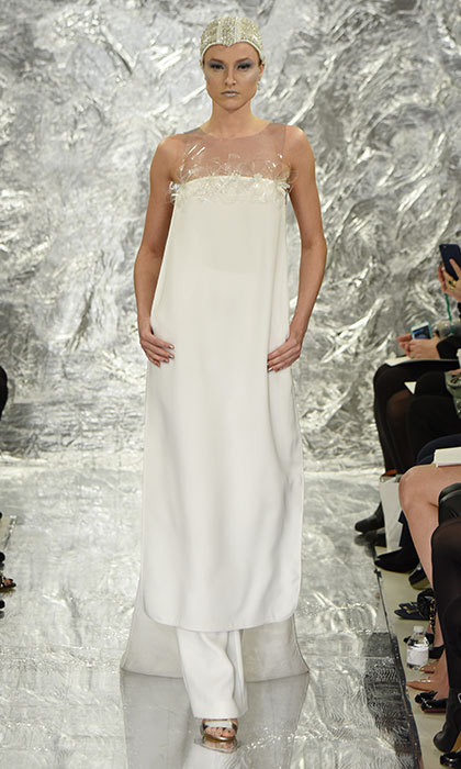 Though the crepe and vinyl tunic gives off a 60's vibe, <b>Theia Bridal</b> brings the look firmly into the 21st century by adding wide trousers underneath. 