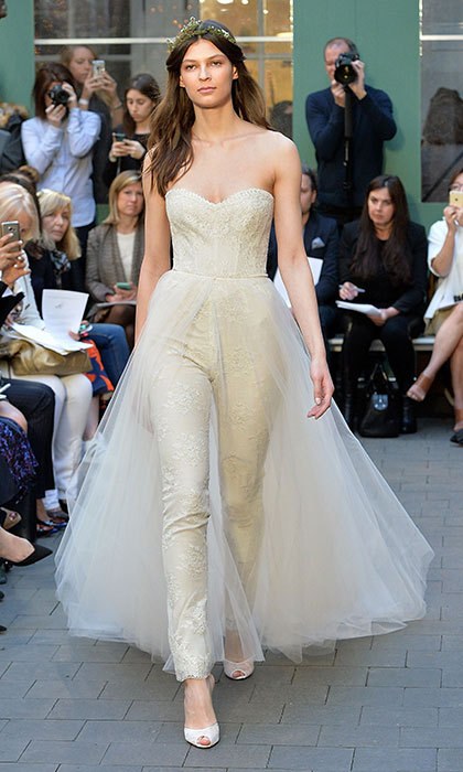 Known for her lavish princess gowns, <b>Monique Lhuillier</b> incorporated trousers and a sculpted sweetheart bustier with a dreamy tulle skirt for an added 'dress' illusion.