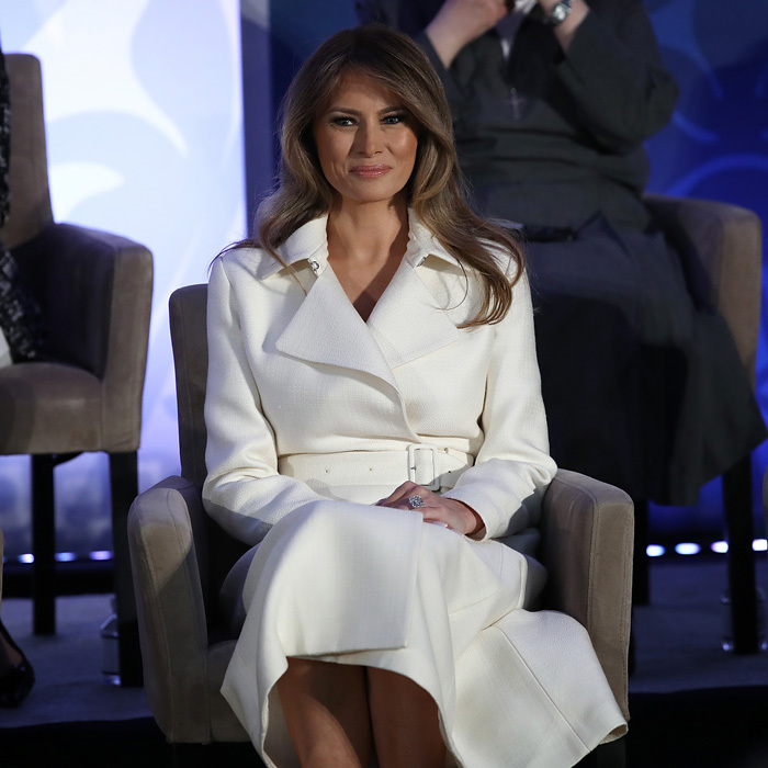 The first lady was a vision in white stepping out for the 2017 Secretary of State's International Women of Courage Awards in D.C. Melania looked elegant wearing a belted ivory coat by The Row and Christian Louboutin pumps for the ceremony. 