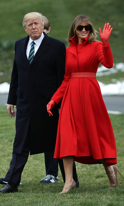 The first lady in red! Melania wowed wearing a custom coatdress by New York–based designer Alice Roi for her journey from the White House to Mar-a-Lago in Palm Beach, Florida.