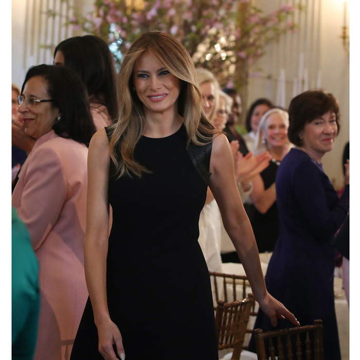 The president's wife hosted a luncheon at the White House in honor of 2017 International Women's Day wearing a sleeveless black wool dress by Ralph Lauren that featured leather trim details on the shoulders.