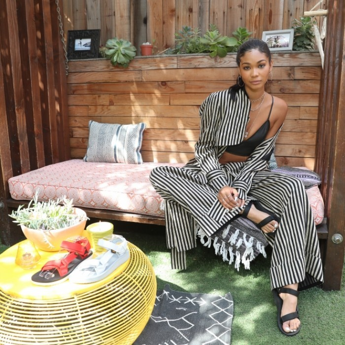 April 5: Happy feet! Chanel Iman hosted the Teva Festival Fashion Styling Suite at Good Times at Davey Wayne's in L.A. The model wore a flowing Petar Petrov pant and jacket paired with an Alexander Wang crop top and the Teva Original Universal in black Teva.