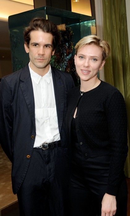April 5: Scarlett Johansson posed with her ex Romain Dauriac at the Singular Object Art Opening Cocktail Reception at 53W53 Gallery in New York City. The friendly exchange comes merely a month after Scarlett filed for divorce.