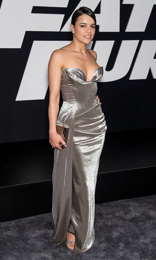 April 8: Michelle Rodriguez unleashed her inner bombshell in a silver sweetheart gown at the New York premiere of <i>Fate of the Furious</i> at Radio City Music Hall.