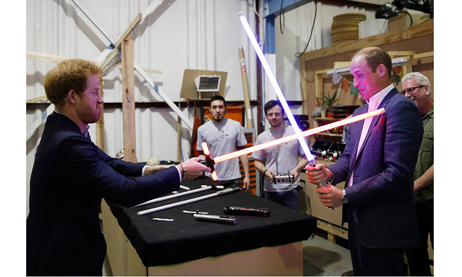 In April 2016 Prince Harry and the Duke of Cambridge try out light sabers during a tour of the Star Wars sets at Pinewood studios in Iver Heath, England. 