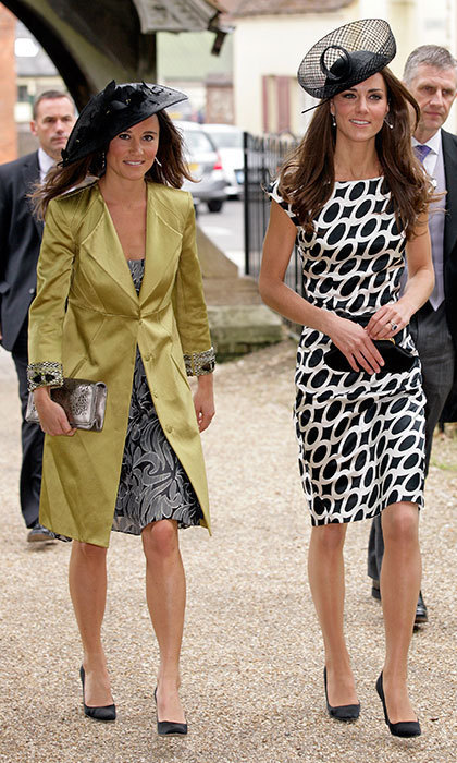 Kate and Pippa Middleton were in step as they attended a wedding at St. Michael and All Angels church on June 11, 2011 in Lambourn, England. 