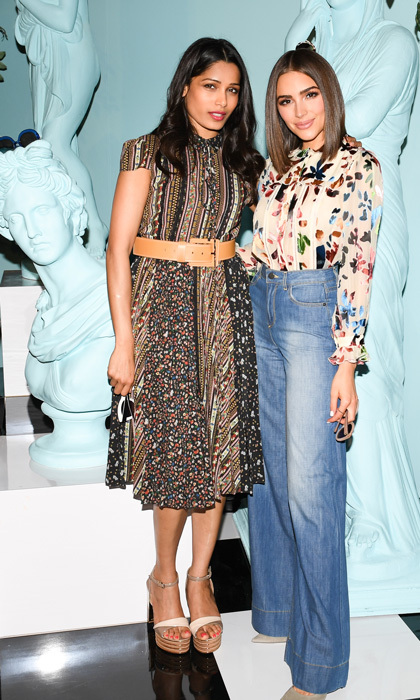 "April 12: Freida Pinto and Olivia Culpo checked out the alice + olivia by Stacey Bendet ""Eyewear is Art"" launch at Greenhouse at Platform in L.A.