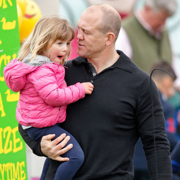 Mia and her dad Mike Tindall were quite the animated duo as she checked out the rides and games at the fair as her mom competed in the race.