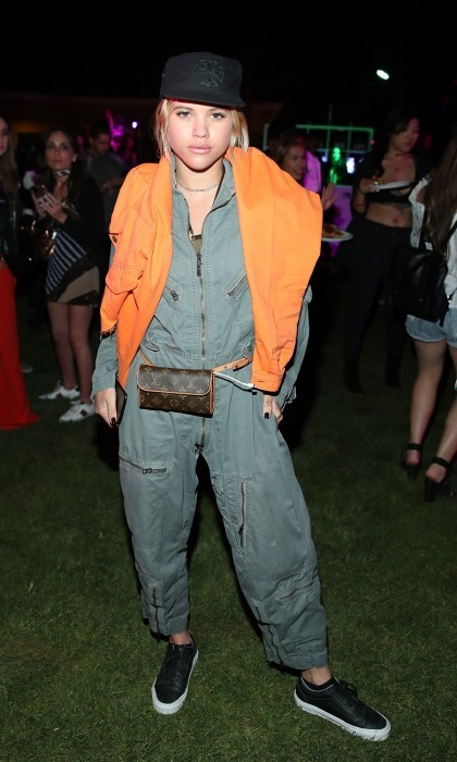 April 14: Sofia Richie attended the NYLON Midnight Garden Party at the festival. Sofia got down to Beyonce's <i>Who Run The World</i> in the lit up garden with fellow partygoer Rita Ora.