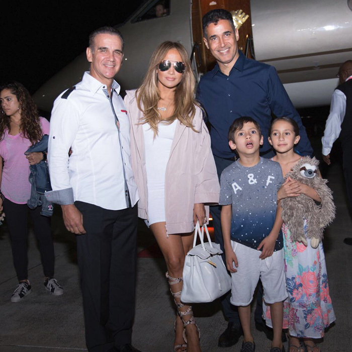 April 14: Jennifer Lopez made a grand entrance into the Dominican Republic with her kids Max and Emme the night prior to her concert at Casa de Campo Resort & Villas.  