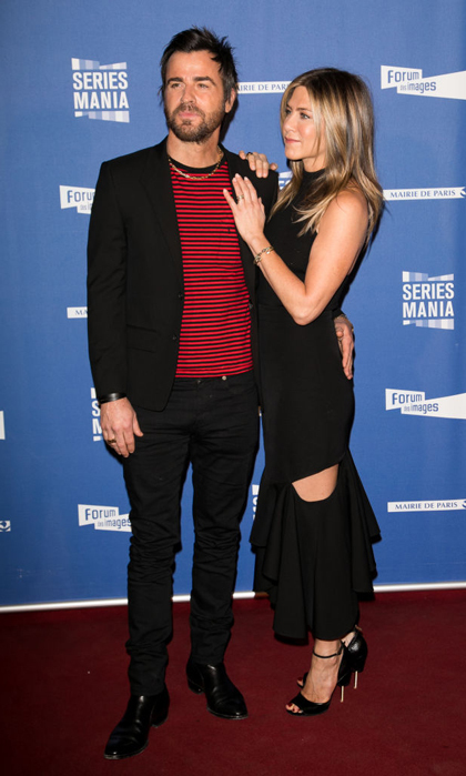 Justin Theroux and Jennifer Aniston had the perfect spots to rest their hands during their second carpet of their Parisian trip in April 2017. 