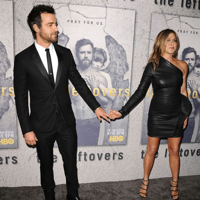 Even when they aren't posing together, the couple, who married in August 2015, can't keep their hands off each other as seen on <i>The Leftovers</i> carpet.