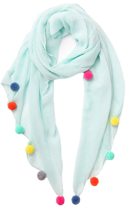 Add a pop of color to your outfit by wearing this playful piece around your neck, tied around your wrist or fastened onto your bag for a spring-ready update. 