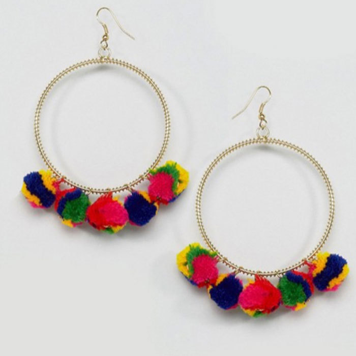 These rainbow-hued earrings are an easy option to try out the pom pom trend and are a great way to add a twist to a simple white tee and jeans oufit.