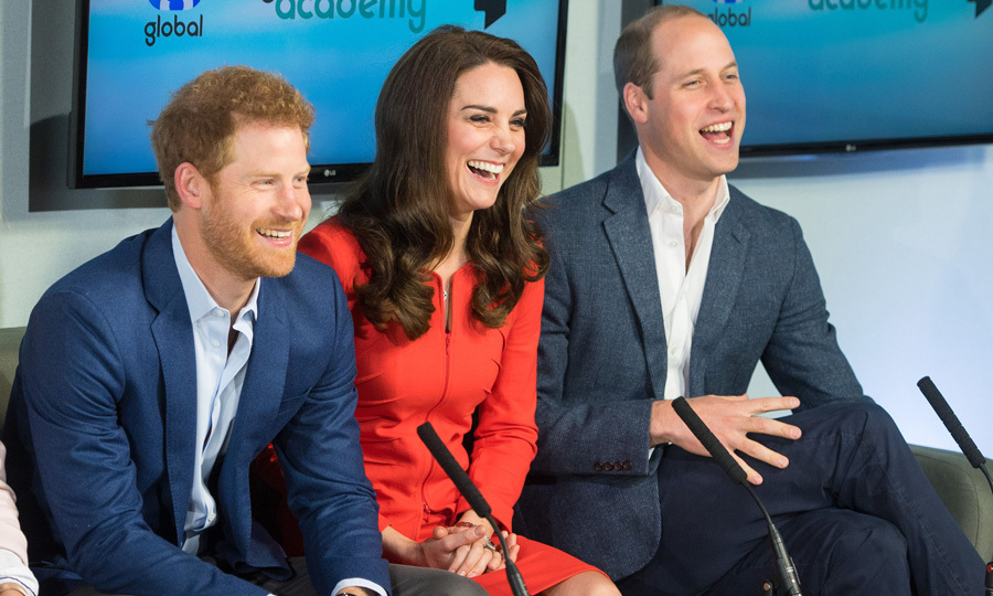 Three heads (and smiles!) are better than one! Harry, William and the Duchess of Cambridge sported matching grins on April 20, 2017 as they helped open the Global Academy in support of the royals' mental health charity Heads Together in Hayes, England. 
