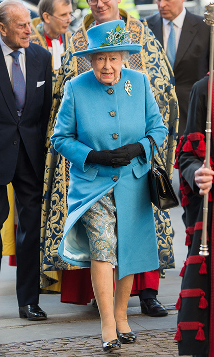 The Queen wore a bright blue coat and matching hat to combine with her paisley silk dress on  Commonwealth Observance Day, March 14, 2016, in London. Completing the outfit – her signature matching gloves, sensible shoes and handbag, which is always on her left arm.