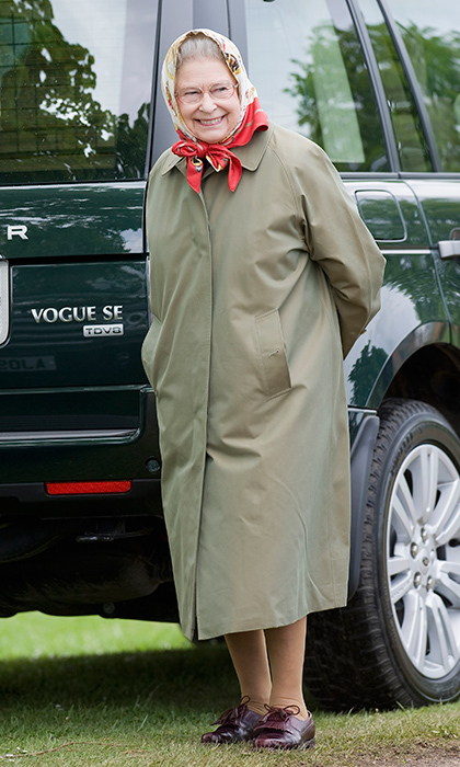 No one does English country casual like Her Majesty! A simple raincoat and signature scarf made the Queen look right at home alongside her Range Rover at the Royal Windsor Horse Show on May 16, 2009.
