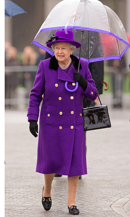 Purple and rain at the new Jubilee Gardens on October 25, 2012. Queen Elizabeth gave a masterclass in accessorizing with her patent leather purse and shoes, and matching hat, coat and gloves – which went perfectly with her clear umbrella, natch.